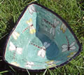 Green triangular clay plate with white dragonflies