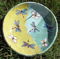 Green and yellow plate with dragonflies and butterflies