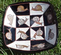 Square plate with snails. Hand made from clay.