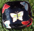 Black clay plate with butterflies