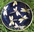 Dark blue clay plate with yellow dragonflies