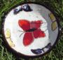 White round plate with butterflies
